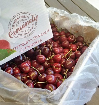Box filled with Cherries